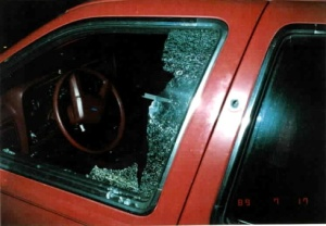 Kait's car window, shattered from the gunshot.